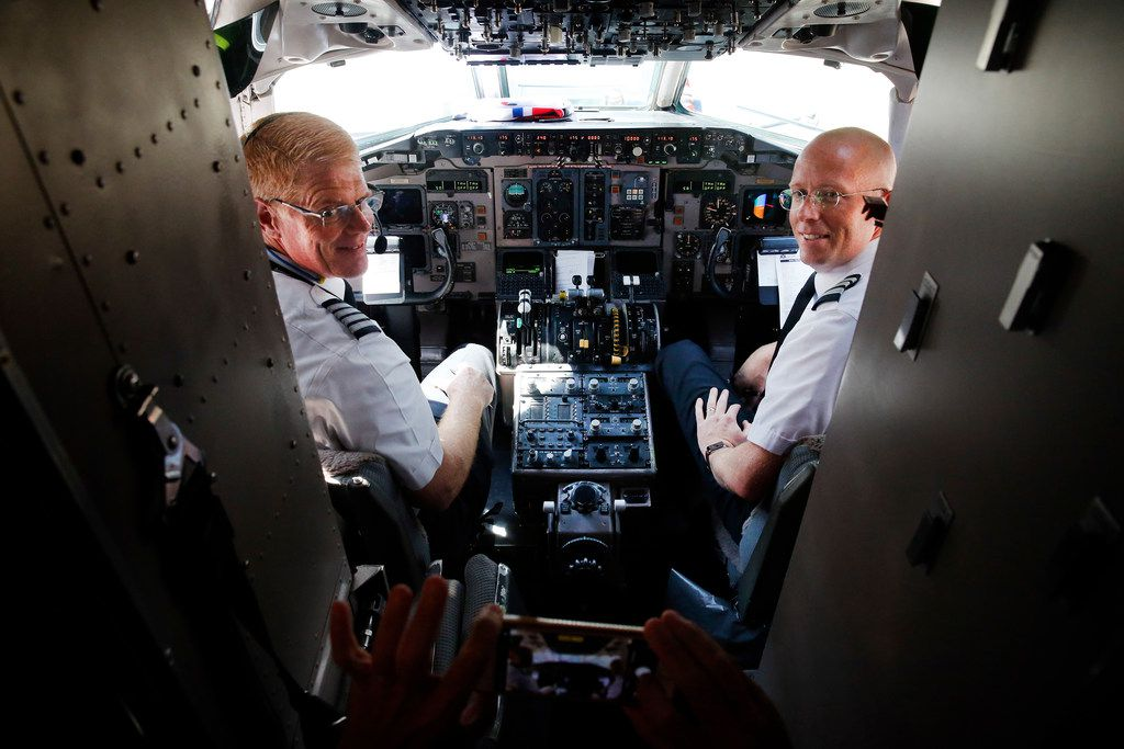 American Airlines MD-80 Captain Bruce Taylor (left) and first Officer David Biggs pose for photos before ferrying flight 9454 to Roswell.