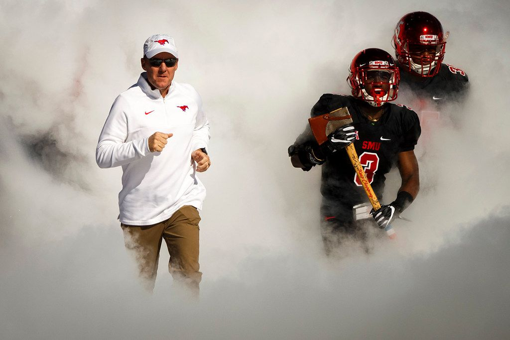 FILE - Coach Chad Morris leads SMU onto the field before a game against Tulane at Gerald J. Ford Stadium on Saturday, Nov. 25, 2017, in Dallas.