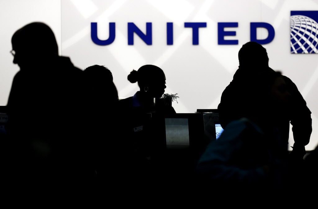 FILE - In this Saturday, Dec. 21, 2013, file photo, travelers check in at the United Airlines ticket counter at Terminal 1 in O'Hare International Airport in Chicago. Starting March 2015, elite members of United's MileagePlus will earn between 7 and 11 miles for every dollar they spend on tickets, not counting taxes. Regular members, those who fly less than 25,000 miles and spend less than $2,500 a year, will get 5 miles per dollar toward free travel. (AP Photo/Nam Y. Huh, File) 06112014xBIZ