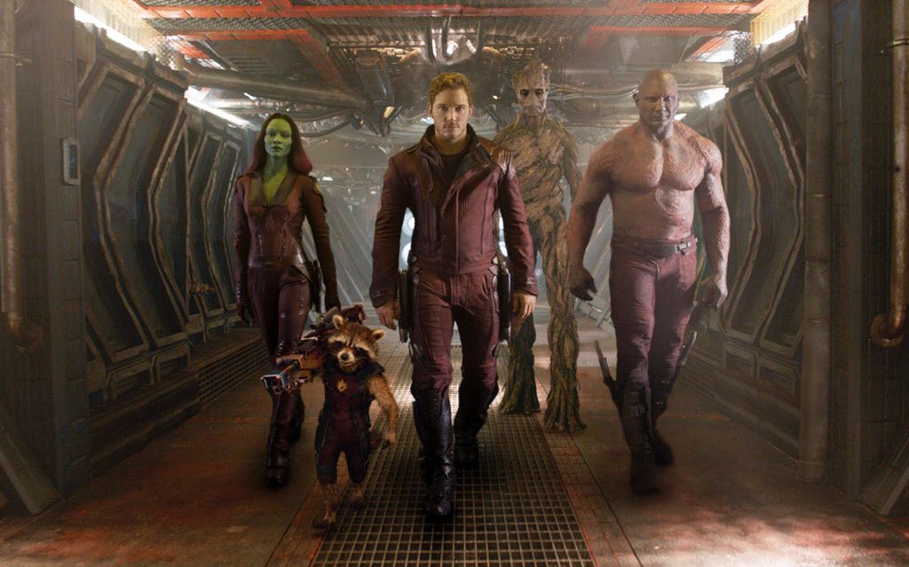 """This undated image released by Disney - Marvel shows, from left, Zoe Saldana, the character Rocket Racoon, voiced by Bradley Cooper, Chris Pratt, the character Groot, voiced by Vin Diesel and Dave Bautista in a scene from """"Guardians Of The Galaxy."""""""