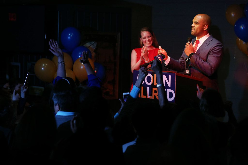 Colin Allred speaks to supporters with his wife Aly Eber during an election night party.