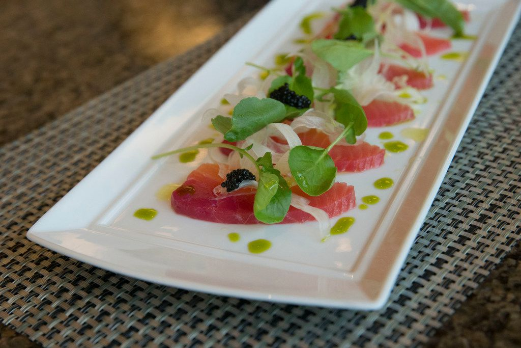 Red beet-cured salmon with shaved fennel, watercress and caviar