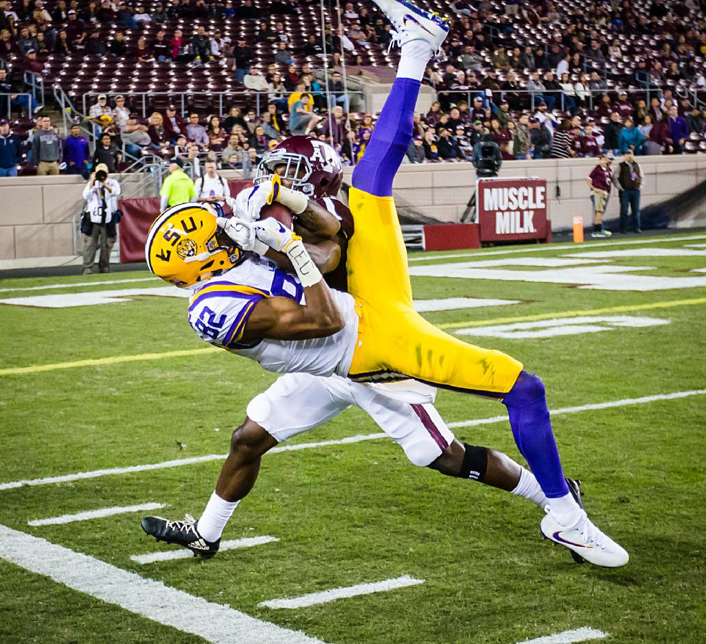LSU wide receiver D.J. Chark (82) can't come down in bounds with a pass as Texas A&M defensive back Alex Sezer (17) defends during the fourth quarter of an NCAA football game at Kyle Field on Thursday, Nov. 24, 2016, in College Station, Texas.  LSU won the game 54-39. (Smiley N. Pool/The Dallas Morning News)
