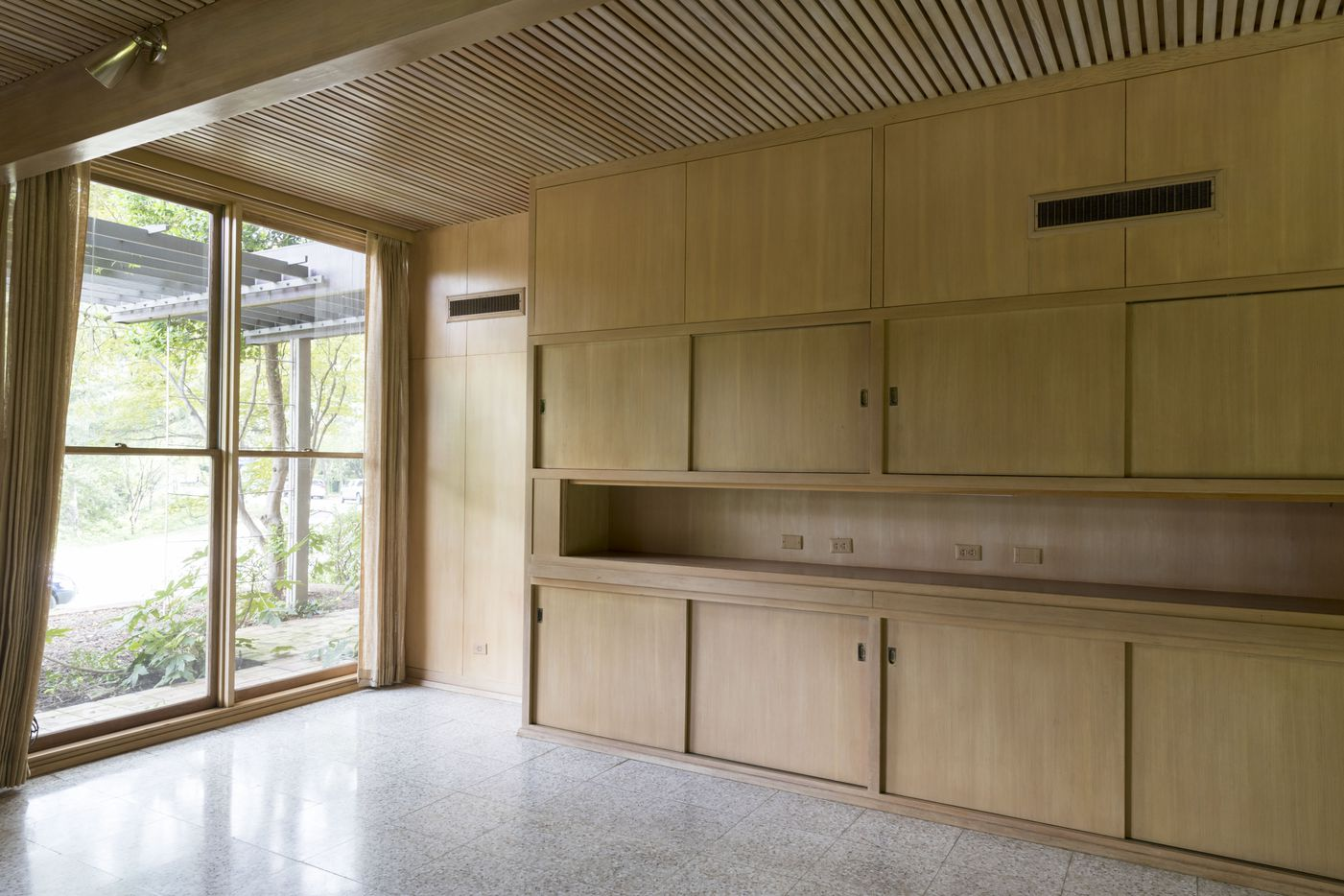 Carpenter Lynn Ford's cabinetry is abundant on both the first and second floors.