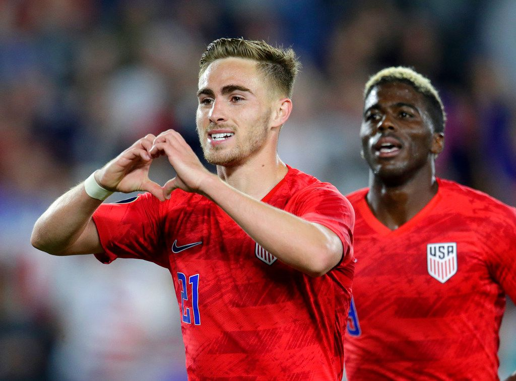 United States' Tyler Boyd, left, celebrates his goal against Guyana with fans as teammate Gyasi Zardes follows during the second half of a CONCACAF Gold Cup soccer match Tuesday, June 18, 2019, in St. Paul, Minn. (AP Photo/Andy Clayton-King)