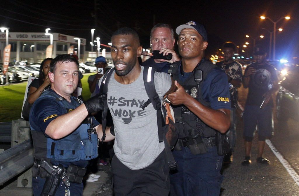 Police arrest activist DeRay Mckesson during a protest in Baton Rouge, La.