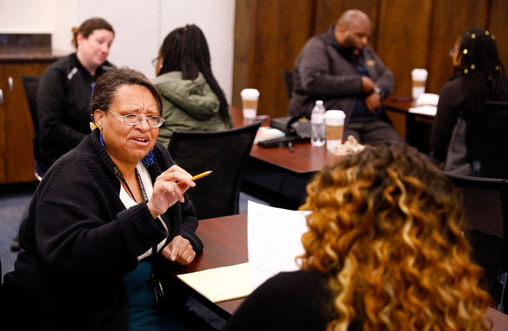 Texas A&M Commerce staff members Terryl Bratek (left) role play a conversation with colleague Brianna Williams (right) during a training class aimed to help identify when someone is struggling with depression or at risk of suicide.