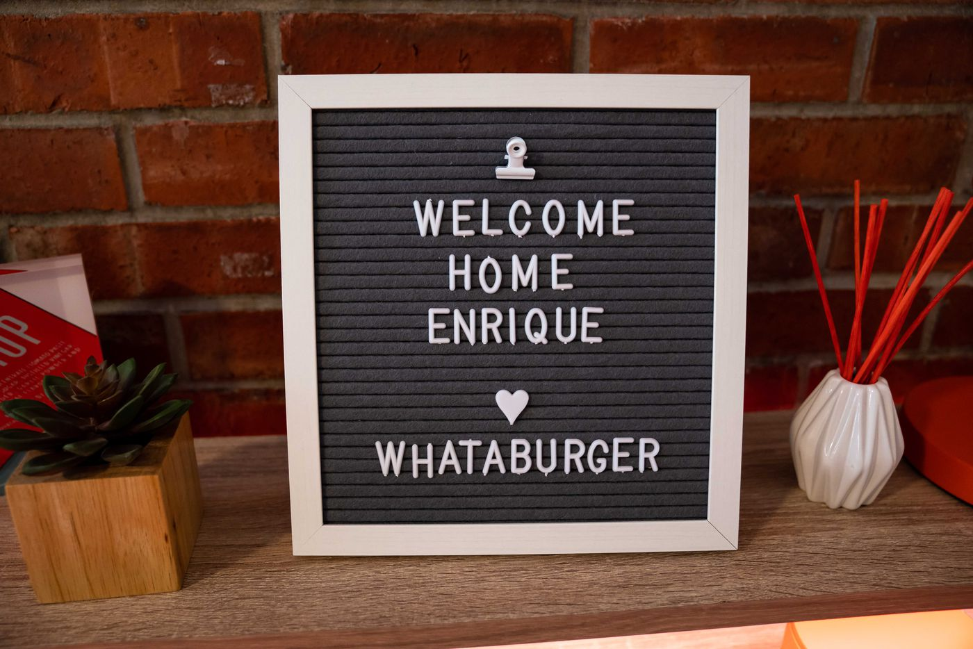 'Welcome home, Enrique. Love, Whataburger,' reads a sign inside Enrique Alcoreza's Trinity University dorm room. Whataburger decorated it for free for him.