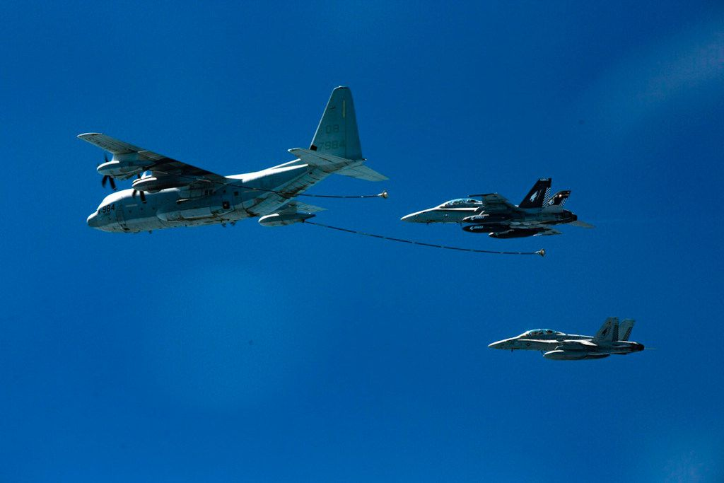 In this Oct. 13, 2016, photo provided by U.S. Marine Corps, two F/A-18D Hornets with Marine All-Weather Fighter Attack Squadron 533 approach a KC-130J with Marine Aerial Refueler Transport Squadron 352 during a refueling exercise in an undisclosed location.