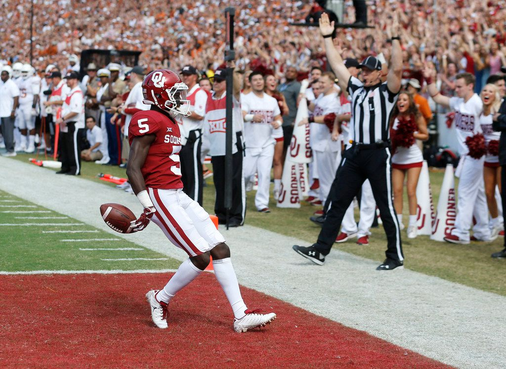 Oklahoma Sooners wide receiver Marquise Brown (5) scores a touchdown in a game against the Texas Longhorns during the first half of play at the Cotton Bowl in Dallas on Saturday, October 6, 2018. (Vernon Bryant/The Dallas Morning News)