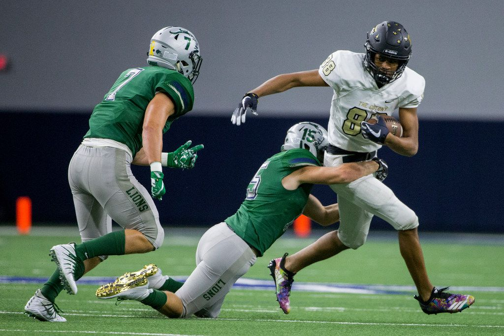 The Colony wide receiver Keith Miller (88) gets tackled by Frisco Reedy defensive back Connor Kiley (15) in the first half of their non district football game on Thursday, Sept. 6, 2018 at The Ford Center at The Star in Frisco, Texas. (Shaban Athuman/ The Dallas Morning News) ORG XMIT: 20041646A