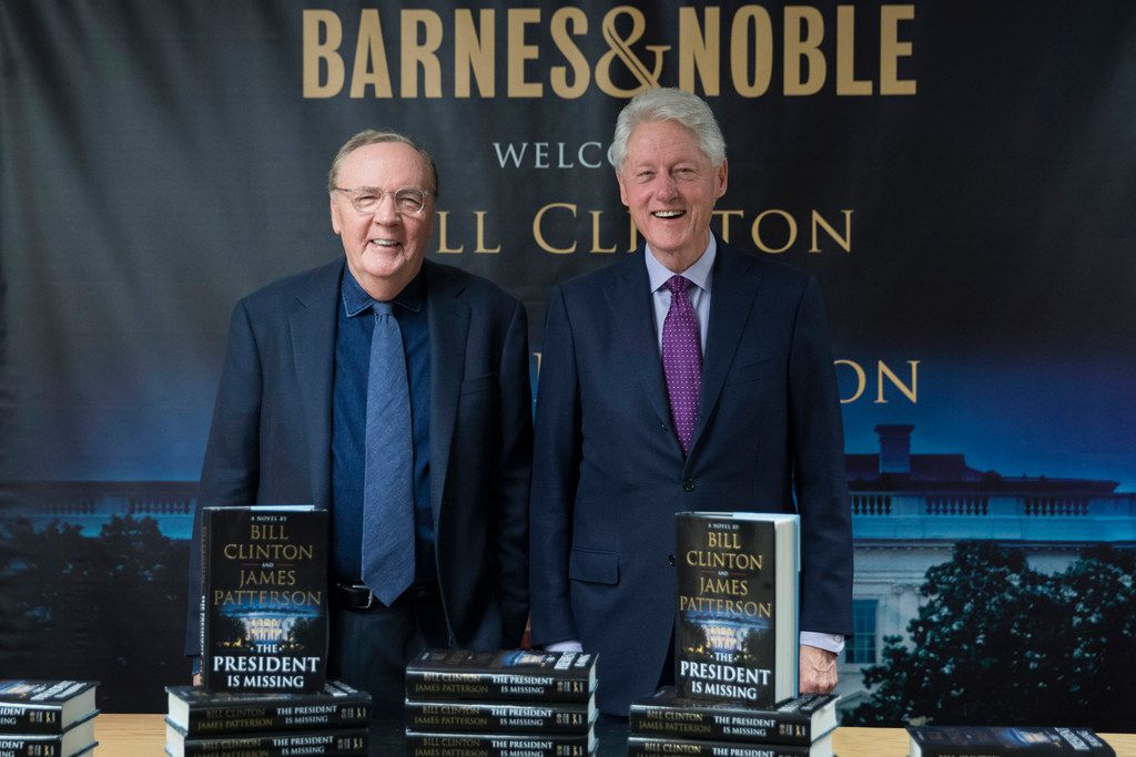 In this June 5, 2018 photo, former President Bill Clinton, right, and author James Patterson pose during an event to promote The President is Missing  in New York.