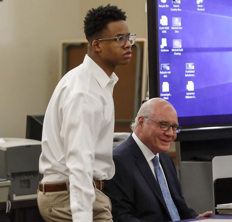 Taymor McIntyre sits down with his defense attorney,  Jeff Kearney, during his trial on Thursday. He was found guilty of murder Friday.