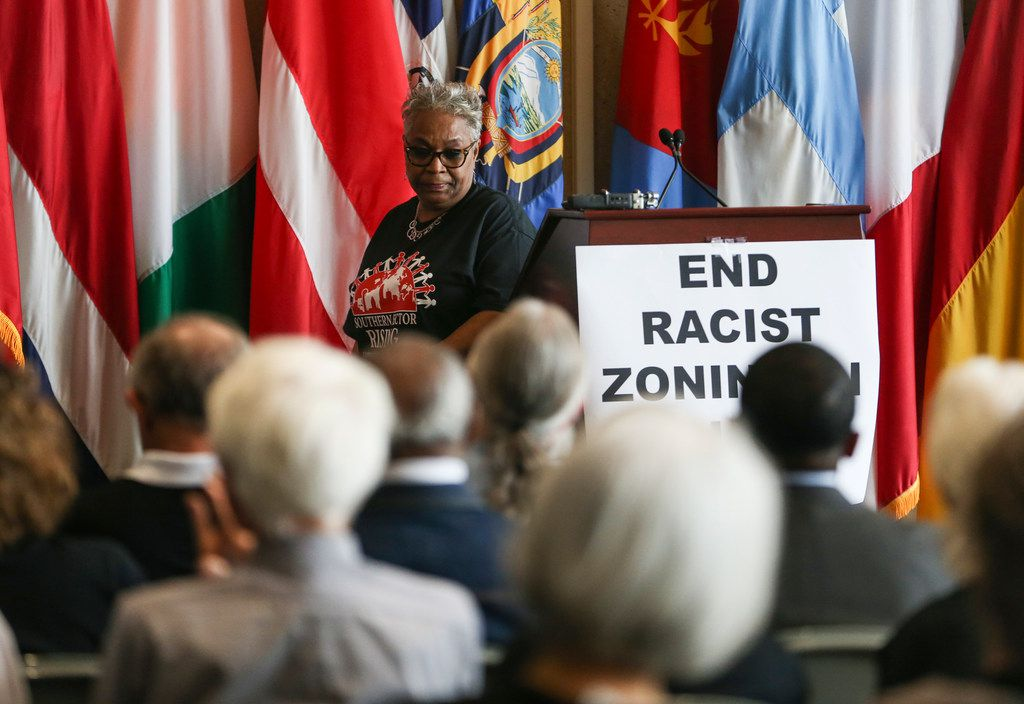 "Marsha Jackson steps away from the podium after speaking during a press conference concerning ""Shingle Mountain"" in south Dallas on March 20, 2019 at City Hall in Dallas."