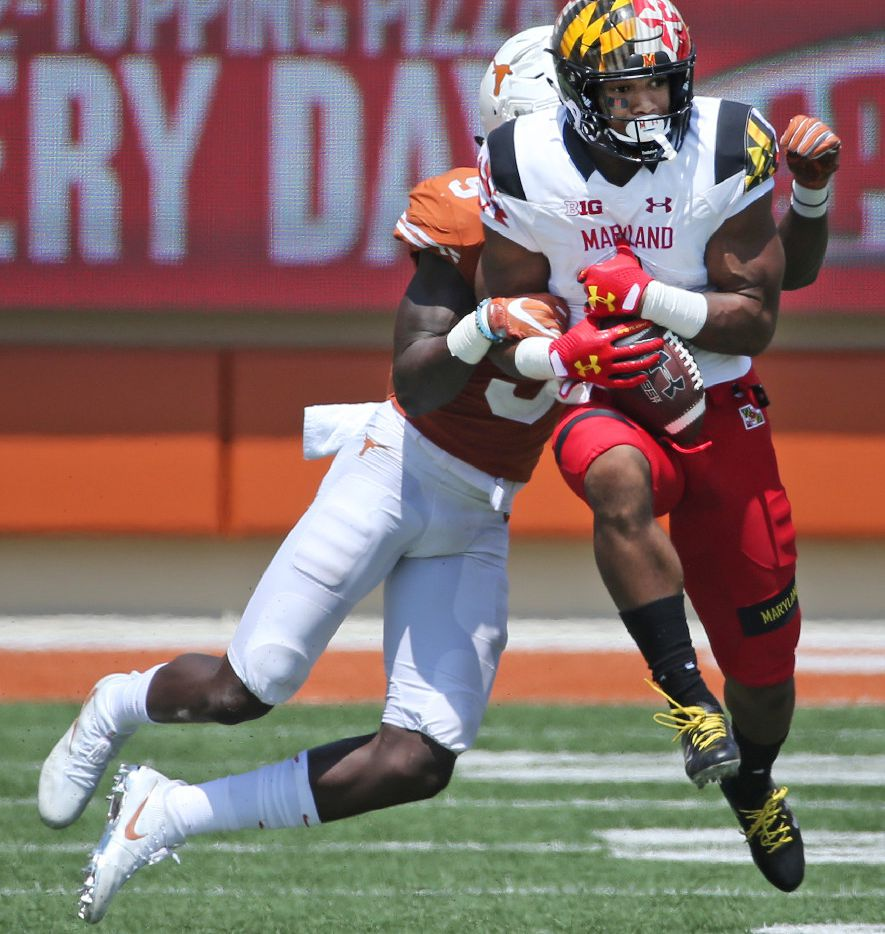 Maryland Terrapins wide receiver D.J. Moore (1) catches a long pass catch over Texas Longhorns defensive back Holton Hill (5) in the third quarter during the University of Maryland Terrapins vs. the University of Texas Longhorns NCAA football game at Darrell K Royal Texas Memorial Stadium in Austin, Texas on Saturday, September 2, 2017. (Louis DeLuca/The Dallas Morning News)