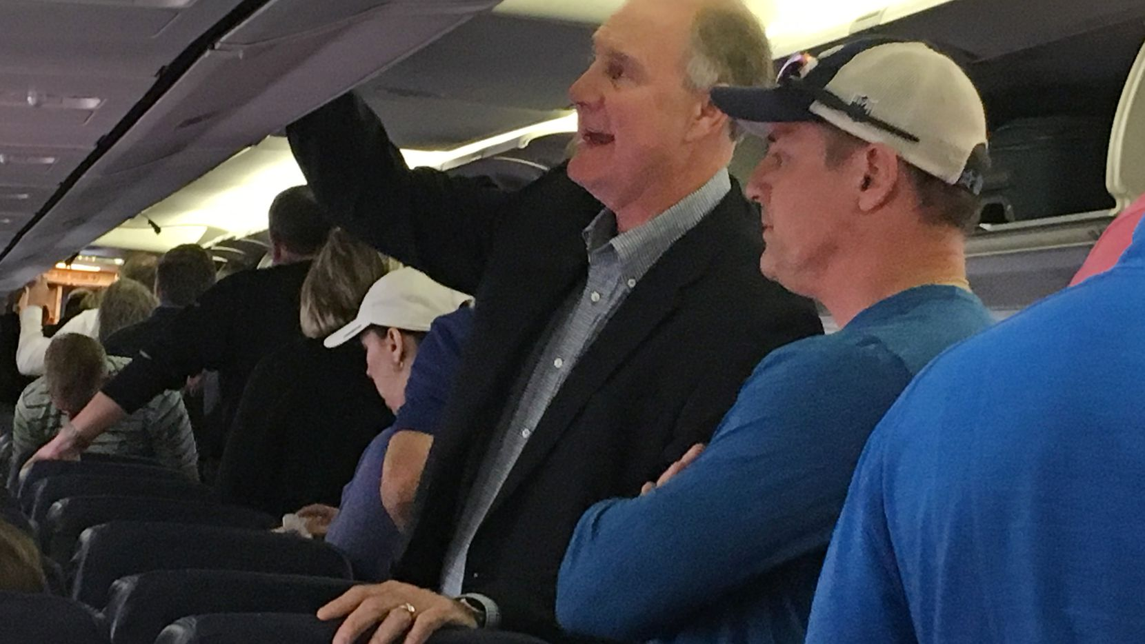 Southwest Airlines CEO Gary Kelly retrieves his bags from the overhead compartment after landing at Love Field on a Southwest flight from Atlanta, Monday, November 13, 2017.  Kelly says he flies with the rest of the passengers - no special treatment.