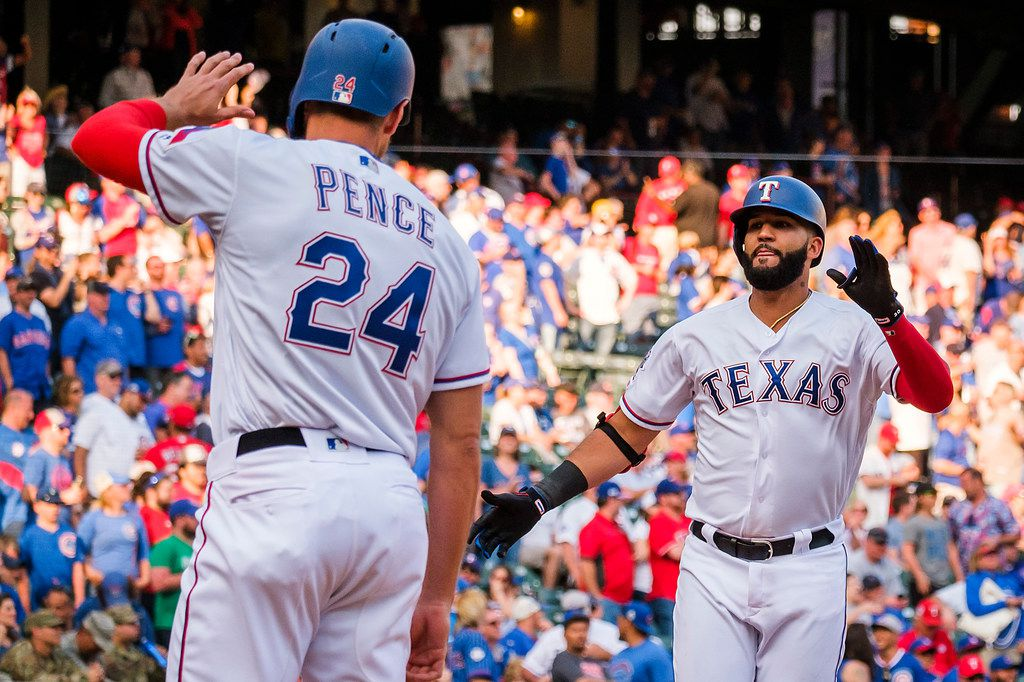 Texas Rangers right fielder Nomar Mazara celebrates with designated hitter Hunter Pence after Mazara hit a two-run home run scoring Pence during the ninth inning against the Chicago Cubs at Globe Life Park on Thursday, March 28, 2019, in Arlington. (Smiley N. Pool/The Dallas Morning News)