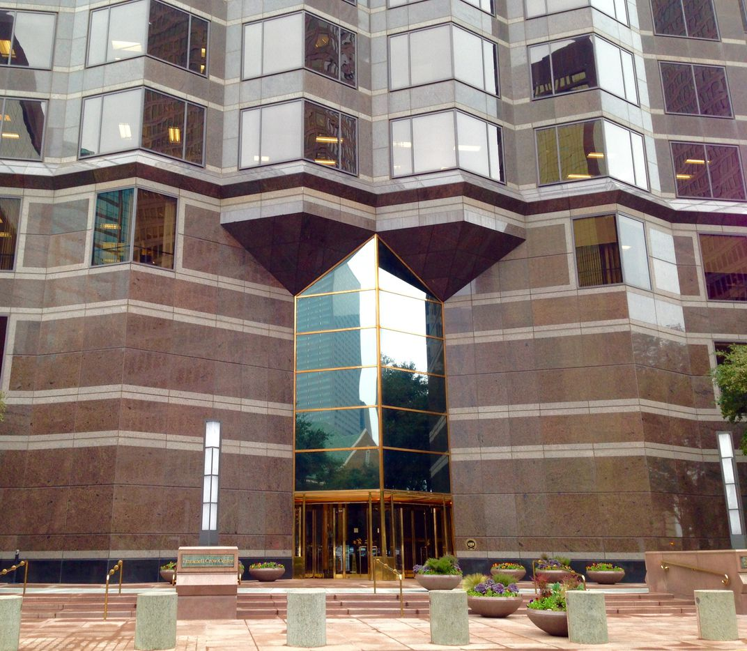 The current front of the Trammell Crow Center has a narrow entry and granite walls.