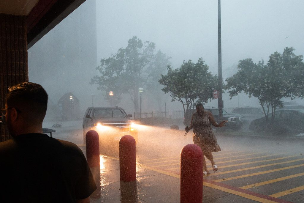 A person runs through a torrential downpour to enter the Target store at Cityplace Market during a severe thunderstorm in Dallas on Sunday, June 16, 2016. (Lynda M. Gonzalez/The Dallas Morning News)