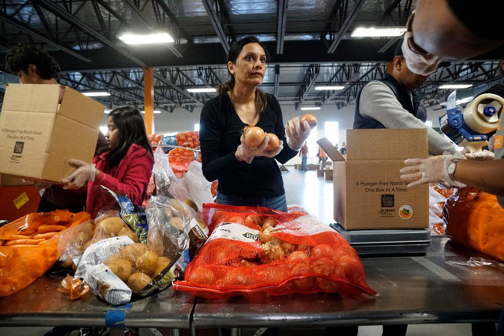 Smita Goyal boxes onions while volunteering with Hunger Mitao at North Texas Food Bank in Plano, Texas on Feb. 23.