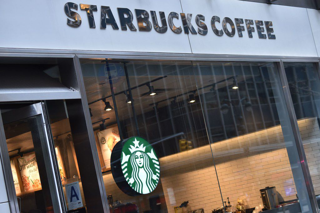 """The sign for a Starbucks Coffee shop is seen in New York on April 17, 2018, following the company's announcement that they will close more than 8,000 US stores on May 29 to conduct """"racial-bias education"""" following the arrest of two black men in one of its cafes."""