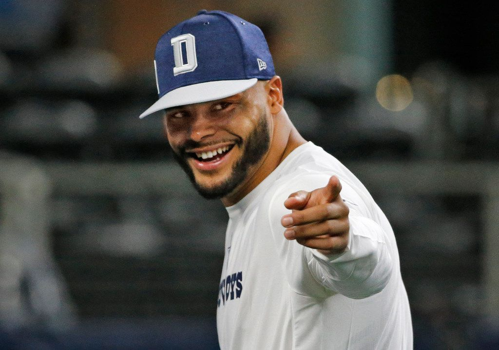 Dallas Cowboys quarterback Dak Prescott (4) gestures to a fan during early warmups before the Detroit Lions vs. the Dallas Cowboys NFL football game held at AT&T Stadium in Arlington, Texas on Sunday, September 30, 2018. (Louis DeLuca/The Dallas Morning News)