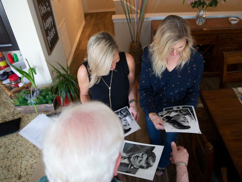 Kennedy presents Robbins (middle) and Leonard signed copies of the photo he took of their mother outside Parkland Hospital.