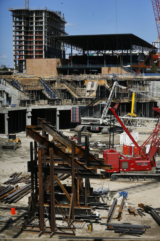 The new Lowe's hotel under construction (upper left) and Texas Live! Arlington Backyard (upper right) are seen from the main concourse of the new Globe Life Field under construction in Arlington, Texas, Tuesday, September 18, 2018. The Texas Rangers and Manhattan Construction celebrated the One Million Man Hours by providing a barbecue lunch for it's nearly 900 construction workers. (Tom Fox/The Dallas Morning News)
