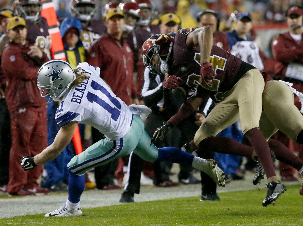 Dallas Cowboys wide receiver Cole Beasley (11) is tackled by Washington Redskins cornerback Josh Norman (24) during the third quarter at FedEx Field on Sunday, Oct. 29, 2017, in Landover, Md. The Cowboys won 33-19. (Jae S. Lee/The Dallas Morning News)