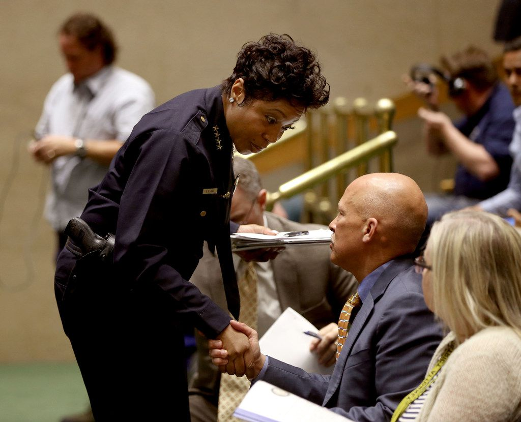 Dallas County District Attorney John Creuzot shakes hands with Dallas Police Chief U. Renee Hall after he spoke with city council members about his police reform policies during a public safety and criminal justice meeting at city hall in Dallas on Monday, April 22, 2019. (Rose Baca/Staff Photographer)