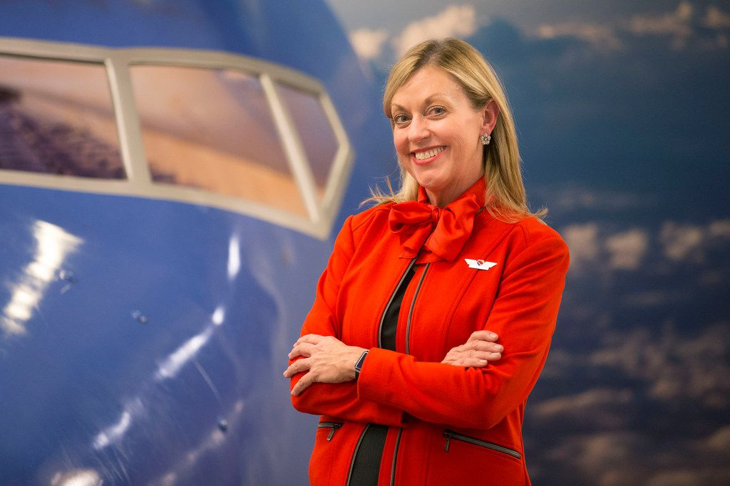 Flight attendant Shari Rood posed for a portrait after she earned her wings at the Southwest Airlines Training and Operational Support building in Dallas. Rood worked for the airline for 35 years before she made the switch to become a flight attendant.