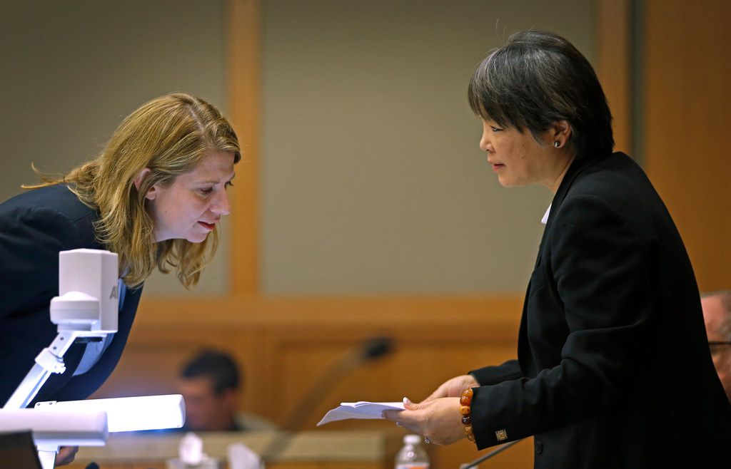 Prosecutor Cynthia Walker (left) talks with defense attorney Maria Tu about a prosecution's exhibit during Jason Lowe's murder trial at the Collin County Courthouse in McKinney, Texas, Tuesday, Sept. 19, 2017.