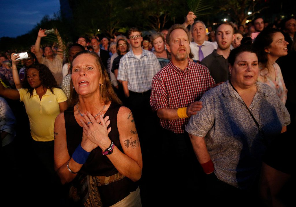 "Kimberly McNally sings ""Amazing Grace"" with other church members during the March for Eternal Life led by members of First Baptist Dallas at Klyde Warren Park in downtown Dallas on Palm Sunday, March 25, 2018. The march comes a day after the March for Our Lives protest for stricter gun control. (Rose Baca/The Dallas Morning News)"