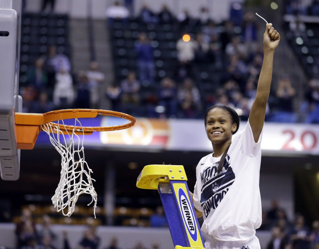 Connecticut's Moriah Jefferson (4) celebrates by cutting down the net after Connecticut's 82-51 victory over Syracuse in the championship game at the women's Final Four in the NCAA college basketball tournament Tuesday, April 5, 2016, in Indianapolis. Connecticut won 82-51. (AP Photo/Michael Conroy)
