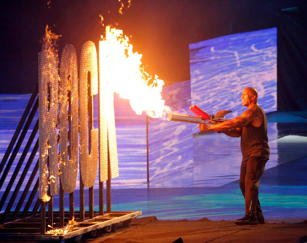The Rock ignites a set piece on fire during his introduction at WrestleMania 32 at AT&T Stadium in Arlington, TX, Sunday, April 3, 2016. (David Guzman/The Dallas Morning News)