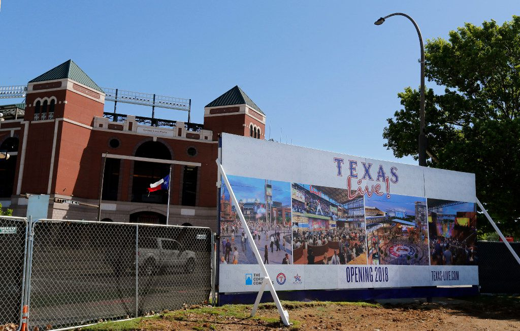 A large sign served as a backdrop to the groundbreaking ceremonies for Texas Live! in Arlington, Wednesday. (Tom Fox/The Dallas Morning News)