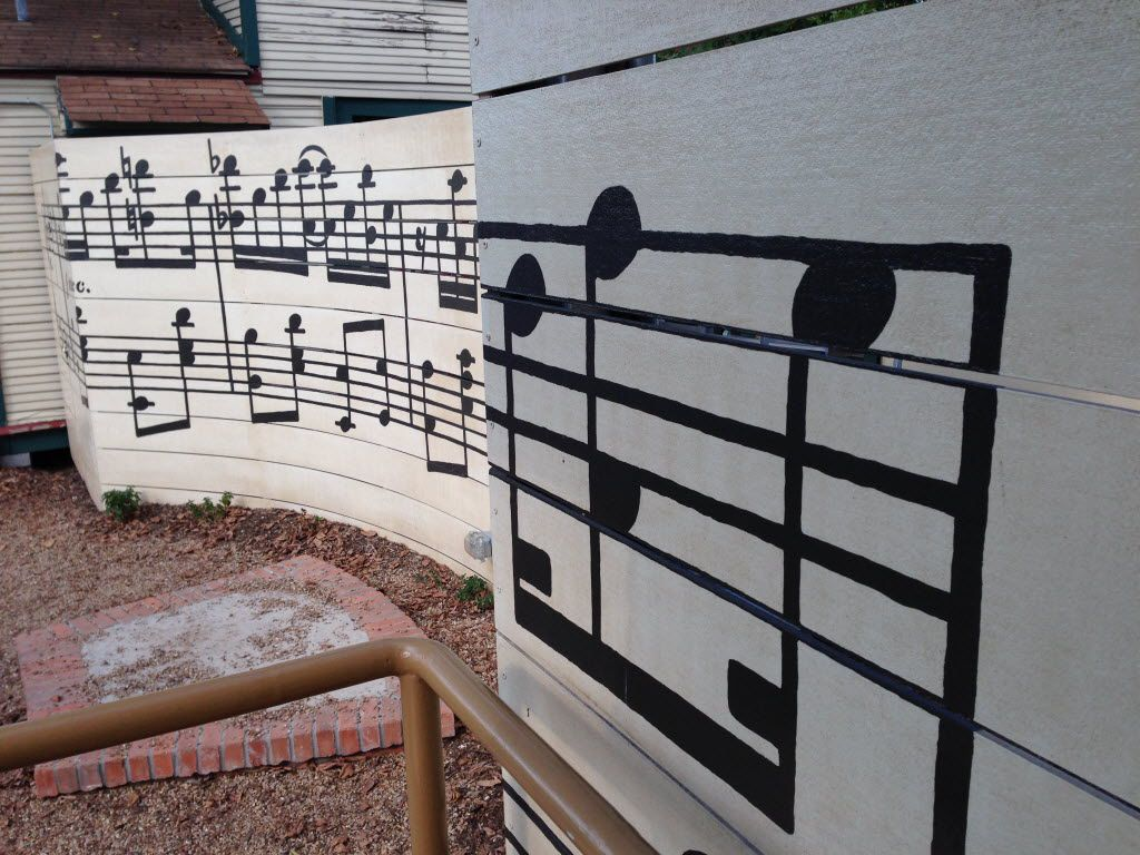 A mural in the Bishop Arts District between Emporium Pies and the Cozy Cottage children's boutique shows two lines of musical notes.