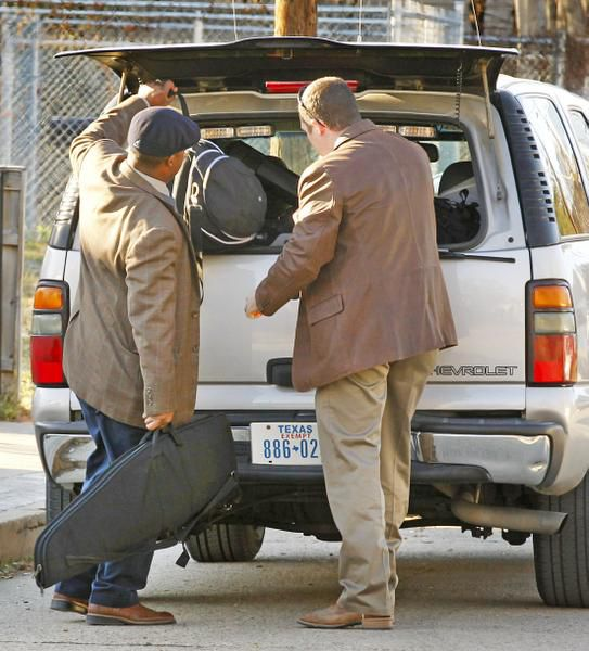 Dallas police loaded items Wednesday from a Cedars neighborhood duplex where Nick and Vanessa Pitofsky were found dead. Police believe the couple had been dead for days.