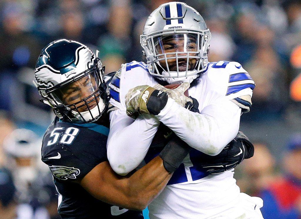 Dallas Cowboys running back Ezekiel Elliott (21) is tackled high by Philadelphia Eagles middle linebacker Jordan Hicks (58) during the second half at Lincoln Financial Field in Philadelphia, Pennsylvania, Sunday, November 11, 2018. (Tom Fox/The Dallas Morning News)