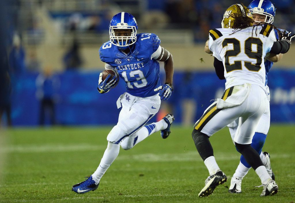 LEXINGTON, KY - NOVEMBER 02:  Jeff Badet#13 of the Kentucky Wildcats runs with the ball during the game against the Alabama State Hornets at Commonwealth Stadium on November 2, 2013 in Lexington, Kentucky.  (Photo by Andy Lyons/Getty Images) LEXINGTON, KY - NOVEMBER 02:  Jeff Badet#13 of the Kentucky Wildcats runs with the ball during the game against the Alabama State Hornets at Commonwealth Stadium on November 2, 2013 in Lexington, Kentucky.  (Photo by Andy Lyons/Getty Images) ORG XMIT: 185476249