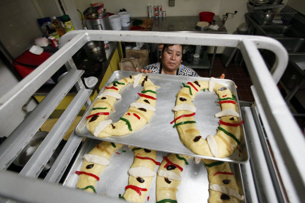 Baker Maria Macrina Hernandez places a Rosca de Reyes on cart prior to baking at Maroches Bakery in the Bishop Arts district.
