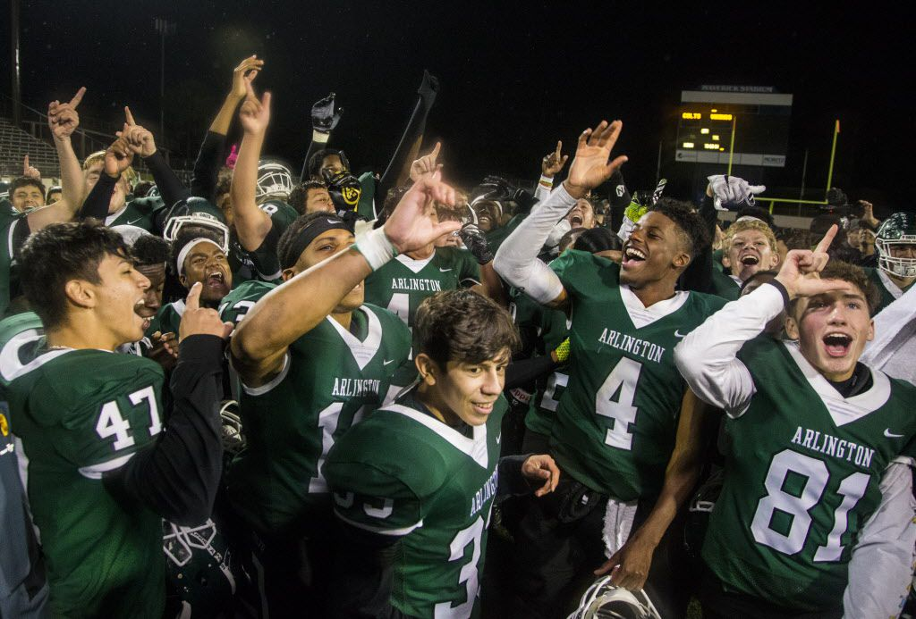 Arlington High School players celebrate after winning the high school football game between Arlington and Lamar High School at Maverick Stadium in Arlington on Nov. 8, 2018. (Carly Geraci/The Dallas Morning News)