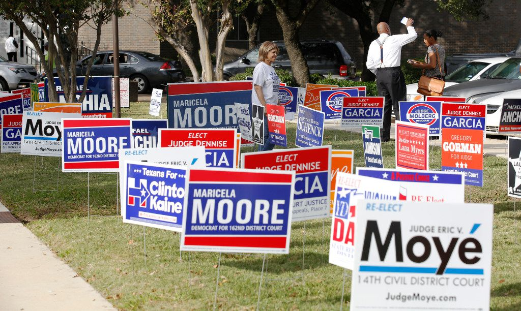Candidates handed out fliers to voters at the Dallas County Government Center, Precinct 5, in Oak Cliff on Oct. 24, 2016.