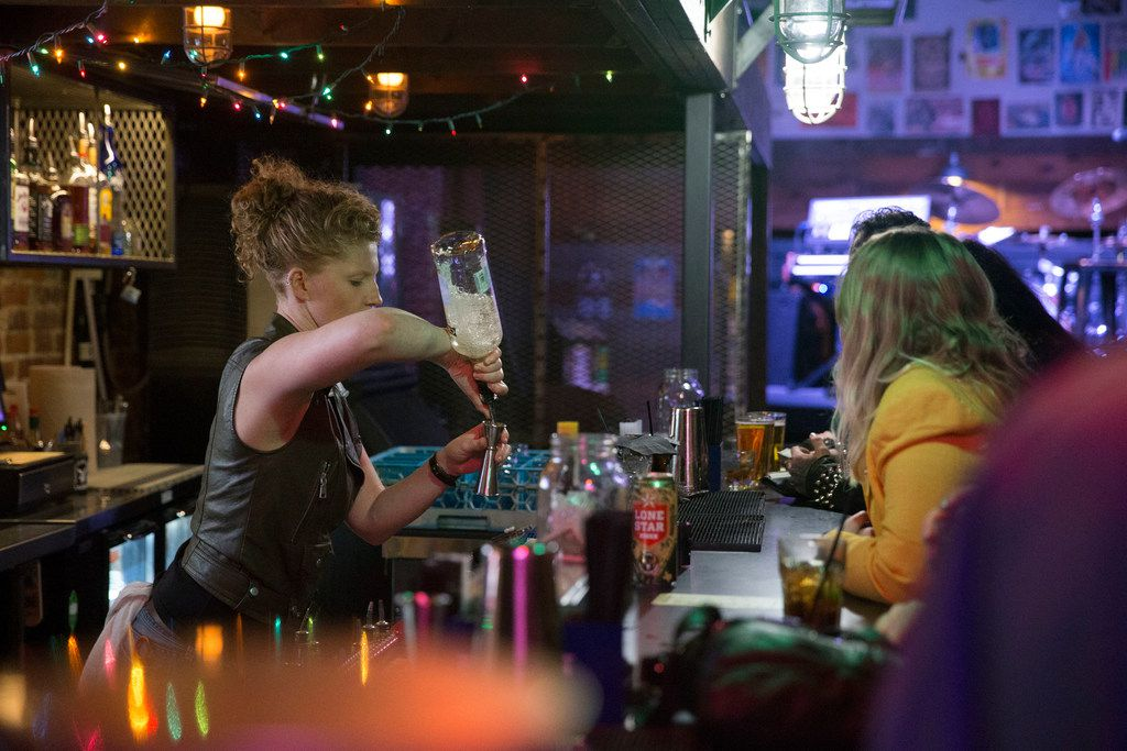 Bartender Caitlin Griffith of Denton pours a drink at Venue located at Andy's Bar and Grill in Denton, Texas on Wednesday, November 28, 2018. Andy's will celebrate its 21 birthday on Saturday. (Daniel Carde/The Dallas Morning News)