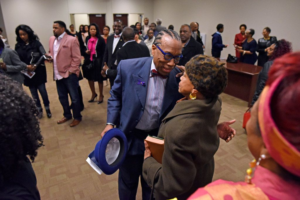 Dallas County Commissioner John Wiley Price greets longtime friend Diane Miles after a Sunday service at Friendship-West Baptist Church. Dallas City Council member Casey Thomas, in a bow tie and black suit, is in the background. (Ben Torres/Special Contributor)