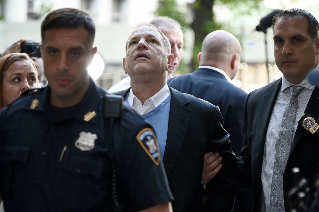 Harvey Weinstein arrives for arraignment at Manhattan Criminal Courthouse in handcuffs after being arrested and processed on charges of rape, committing a criminal sex act, sexual abuse and sexual misconduct on May 25, 2018 in New York City.