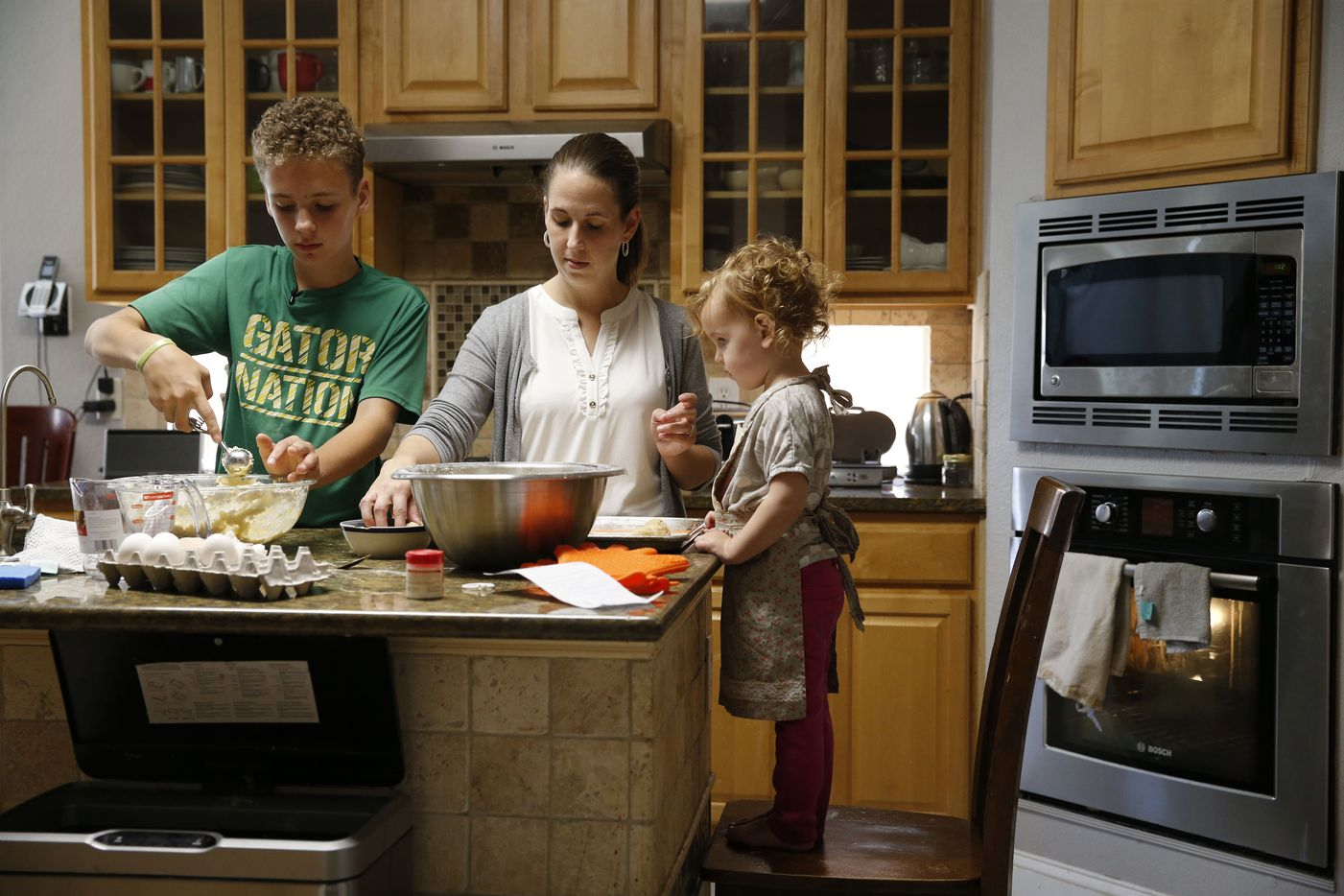 Brian, Laura and Sariah Ellis work on making snickerdoodles at their Frisco home. Brian started a cookie of the month program to help raise funds to train a diabetic alert dog.