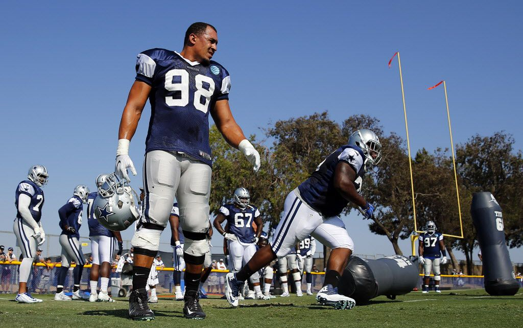 Dallas Cowboys defensive tackle Tyrone Crawford (98) returned to afternoon practice after being held out with a cautionary injury at training camp in Oxnard, California, Tuesday, August 9, 2016. Here the defensive lineman work on rushing drills. (Tom Fox/The Dallas Morning News)
