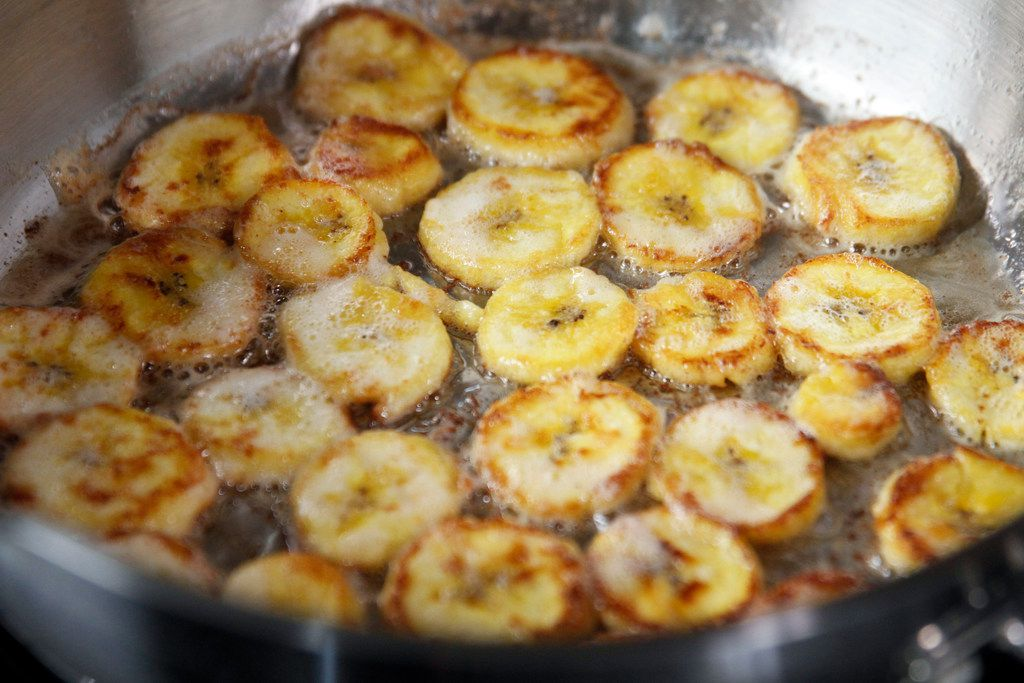 Sliced plantains cooking in Miyoko's Cultured Vegan Butter