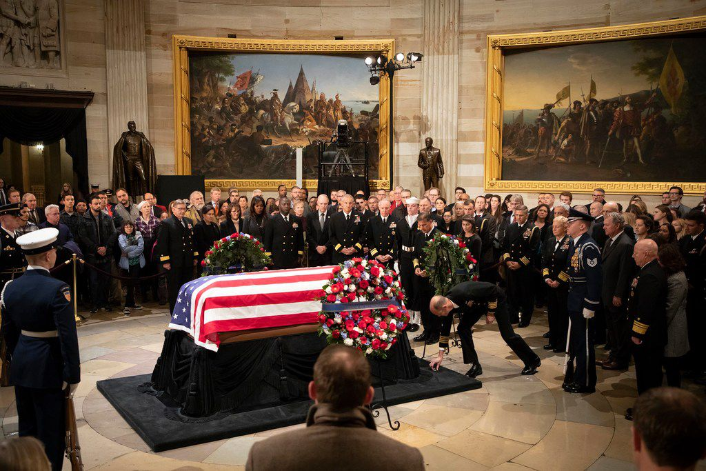 Commanders of the aircraft carrier USS George H.W. Bush pay their respects to the President George H.W. Bush as he lies in the Rotunda of the U.S. Capitol on Tuesday, Dec. 4, 2018, in Washington.